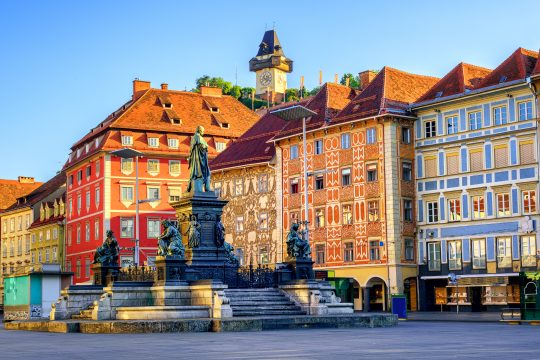 Painted facades and the Clock Tower in the old town of Graz, Austria